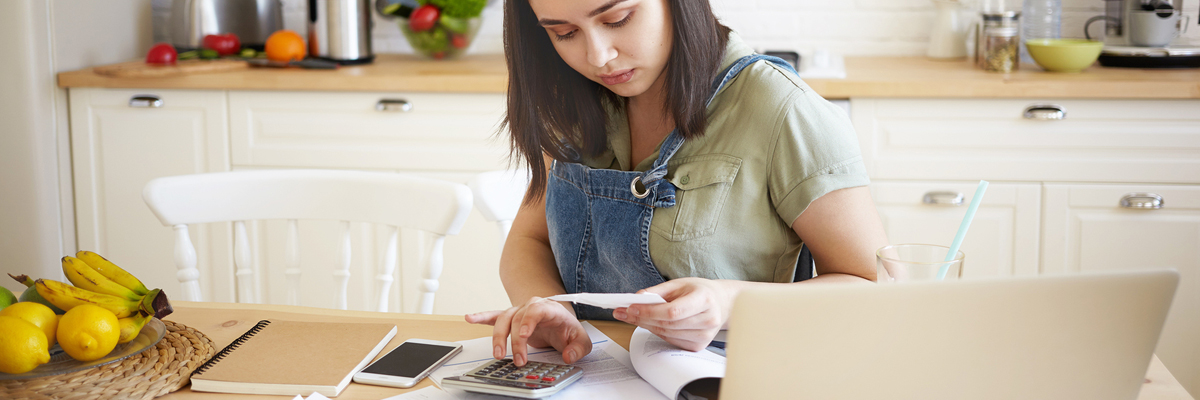 Girl with paper calculating payment