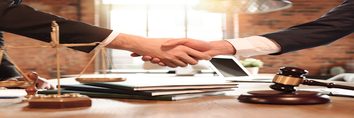 Lawyer And His Client Handshake. Agreement With Attorney In Offi